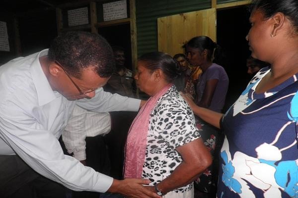Pastor Conan Praying for the sick